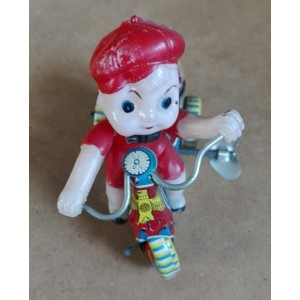 Wind up bambino su triciclo in latta vintage
